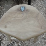 Solder filled  hole ontop of oak stool seat.